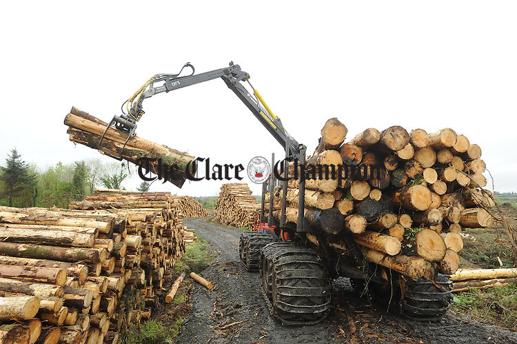 Robert Regan from Galway takes a break from his work on a tree forwarder in forestry near Kilmihil. Photograph by John Kelly.