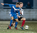 Montrose's 19 (not on team sheet) and Shire's Graeme McGregor challenge for the ball.