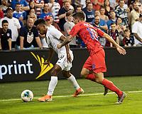 KANSAS CITY, KS - JUNE 26: Christian Pulisic #10 defends against Edgar Barcenas #10 during a game between Panama and USMNT at Children's Mercy Park on June 26, 2019 in Kansas City, Kansas.