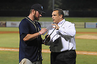 The Mobile BayBears catcher Josh Ford #30 is presented the MVP Award by Steve Desalvo after game four of the Southern League Championship Series between the Mobile Bay Bears and the Tennessee Smokies at Smokies Park on September 18, 2011 in Kodak, Tennessee.  The BayBears won the Southern League Championship 6-4.  (Tony Farlow/Four Seam Images)