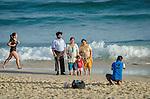 An Indian family poses for a photograph on Bondi Beach in Sydney, Australia