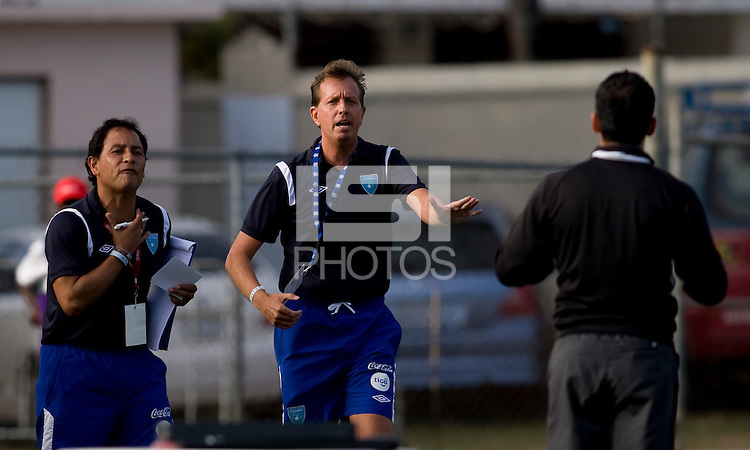Guatemala head coach Gary Stempel talks to the fourth official during the group stage of the CONCACAF Men's Under 17 Championship at Jarrett Park in Montego Bay, Jamaica. Trinidad & Tobago defeated Guatemala, 1-0.