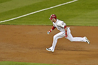 12 October 2012: Washington Nationals rookie outfielder Bryce Harper hustles to third with an RBI triple, scoring Jayson Werth, in the first inning of Postseason Playoff Game 5 of the National League Divisional Series against the St. Louis Cardinals at Nationals Park in Washington, DC. The Cardinals rallied with four runs in the 9th inning to defeat the Nationals 9-7; thus winning the NLDS and moving on to the NL Championship Series. Mandatory Credit: Ed Wolfstein Photo