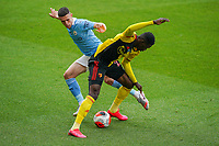 Phil Foden of Man City and Ismaila Sarr of Watford during the Premier League match between Watford and Manchester City at Vicarage Road, Watford, England on 21 July 2020. Football Stadiums around remain empty due to the Covid-19 Pandemic as Government social distancing laws prohibit supporters inside venues resulting in all fixtures being played behind closed doors until further notice.<br /> Photo by Andy Rowland.