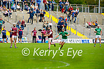 Causeway's Dan Goggin and Ballyduff's Kevin Goulding running to gain possession of the sliotar in round 2 of the County Senior Hurling championship,