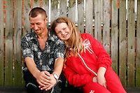 In 2007, Olga Feshenko suggested hope for Ivankiv's future. At fifteen, she seemed happy riding bikes and flirting with her boyfriend Vanya Kulik, left. A year later, Olga was the youngest widow in Ivankiv, Ukraine. She got pregnant soon after this photo, and married Vanya. When their baby was 2 months old, Vanya died in a car crash. Now Olga is eighteen. She lives with her new husband and is committed to finishing high school. Despite everything, she plans to stay here.  <br /> ------------------- <br /> This photograph is part of Michael Forster Rothbart's After Chernobyl documentary photography project.<br /> © Michael Forster Rothbart 2007-2010.<br /> www.afterchernobyl.com<br /> www.mfrphoto.com <br /> 607-267-4893 o 607-432-5984<br /> 5 Draper St, Oneonta, NY 13820<br /> 86 Three Mile Pond Rd, Vassalboro, ME 04989<br /> info@mfrphoto.com<br /> Photo by: Michael Forster Rothbart<br /> Date:  8/2007    File#:  Canon 20D digital camera frame 14541 <br /> ------------------- <br /> Original caption: .Photo title:.Olga and Vanya before they married..Caption:.In 2007, Olga Feshenko represented hope for Ivankiv's future to me. At fifteen, she was an orphan living with her grandparents, yet nevertheless seemed happy, riding bikes and flirting with her boyfriend Vanya Kulik, left...A year later, Olga was Ivankiv's youngest widow. She got pregnant soon after this photo, and married Vanya. When their baby was 2 months old, Vanya died in a car crash. Olga's grandfather also died that summer...Now Olga is seventeen. She lives with her new husband. She spends most of her time with her son Vova, but is committed to finishing her last year of high school. Despite everything, she plans to stay here...Quote: none.-------------------..