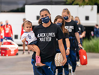 HOUSTON, TX - JUNE 10: Alex Morgan #13 of the USWNT walks into the stadium with her daughter, Charlie Carrasco before a game between Portugal and USWNT at BBVA Stadium on June 10, 2021 in Houston, Texas.