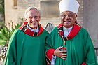 October 9, 2021; Wilton Cardinal Gregory, Archbishop of Washington, D.C., poses for a photo with University of Notre Dame President Rev. John I. Jenkins, C.S.C. following a Mass at the Basilica of the Sacred Heart concluding the 31st Annual Meeting of the Black Catholic Theological Symposium. (Photo by Peter Ringenberg/University of Notre Dame)