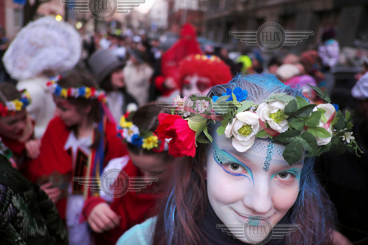 A woman wearing the wreath out of flowers celebrates the Zizkov Mardi Gras Parade.