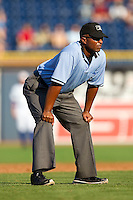 Third base umpire Kelvin Bultron during the first game of a double header between the Charlotte Knights and the Durham Bulls at Durham Bulls Athletic Park on August 28, 2011 in Durham, North Carolina.   (Brian Westerholt / Four Seam Images)