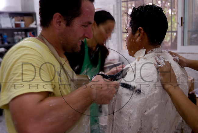 Artist Jason deCaires Taylor cuts away at the mold that will be used to make a statue for the Underwater Sculpture Museum in the waters off Cancun, Mexico. Scheduled for completion in december 2010, over 400 sculptures are to be placed on the sea floor, creating the world's largest underwater museum.