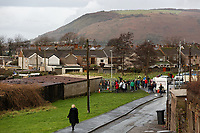 "Pictured: Crowds arrive to see and take pictures of the Banksy graffiti on a garage in Port Talbot, Wales, UK. Thursday 20 December 2018<br /> Re: The artist Banksy has confirmed that a new graffiti piece that has appeared in Port Talbot, south Wales is his.<br /> He announced on Instagram: ""Season's greetings"" - with a video of the artwork in the Taibach area of Port Talbot.<br /> The image appears on two sides of a garage in a lane near Caradog Street, depicting a child enjoying snow falling - the other side reveals it is a fire emitting ash.<br /> The owner of the garage said he had not slept over fears it might be vandalised."