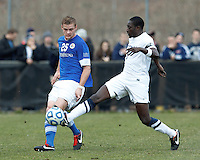 Creighton University defender Jake Brown (25) pass eludes University of Connecticut forward Stephane Diop (5)..NCAA Tournament. Creighton University (blue) defeated University of Connecticut (white), 1-0, at Morrone Stadium at University of Connecticut on December 2, 2012.