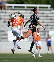 Holly King (16) of the D.C. United Women goes up for a header with Michelle Moll (23) of the Charlotte Lady Eagles during the game at the Maryland SoccerPlex in Boyds, Maryland.  The D.C. United Women defeated the Charlotte Lady Eagles, 3-0, to win the W-League Eastern Conference Championship.