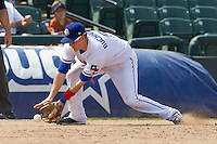 Round Rock Express third baseman Alex Buchholz (5) fields a ground ball against the Colorado Springs Sky Sox in the Pacific Coast League baseball game on May 19, 2013 at the Dell Diamond in Round Rock, Texas. Colorado Springs defeated Round Rock 3-1 in 10 innings. (Andrew Woolley/Four Seam Images).