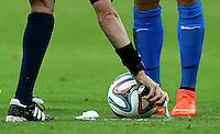 Referee Benjamin Williams sprays the vanishing spray to mark where a free kick should be taken