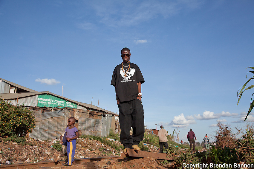23-year-old hip-hop artist Octopizzo on the railroad tracks in Kibera.