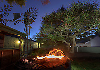 The entertainment courtyard of the Pig and Whistle Hotel in Bathurst with grill area and windmill.
