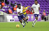 ORLANDO CITY, FL - JANUARY 31: Daryl Dike #19 of the United States moves to the ball during a game between Trinidad and Tobago and USMNT at Exploria stadium on January 31, 2021 in Orlando City, Florida.