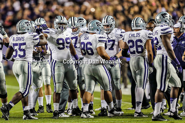 Kansas State Wildcats defensive end Adam Davis (55), Kansas State Wildcats defensive lineman Javonta Boyd (99),Kansas State Wildcats wide receiver Tramaine Thompson (86) and Kansas State Wildcats linebacker Jarell Childs (26) in action during the game between the Kansas State Wildcats and the TCU Horned Frogs  at the Amon G. Carter Stadium in Fort Worth, Texas. Kansas State defeats TCU 23 to 10...