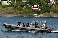 Member of anti terror unit Delta in a RIB boat during an exercise in the Oslofjord.