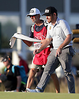 17th July 2021; Royal St Georges Golf Club, Sandwich, Kent, England; The Open Championship Golf, Day Three; Louis Oosthuizen (RSA) with his caddie on the 18th green