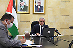 Palestinian Prime Minister Mohammed Ishtayeh speaks during seminar in front of the Foreign Affairs Committee of the European Parliament, in the West Bank city of Ramallah, on April 22, 2021. Photo by Prime Minister Office