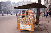 Krakow, Poland. Man selling snacks on the street.