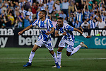 CD Leganes's Oscar Rodriguez and Youssef En-Nesyri celebrate goal during La Liga match between CD Leganes and FC Barcelona at Butarque Stadium in Madrid, Spain. September 26, 2018. (ALTERPHOTOS/A. Perez Meca)