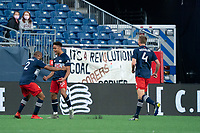 FOXBOROUGH, MA - MAY 1: Andrew Farrell #2 of New England Revolution and Brandon Bye #15 of New England Revolution celebrate the New England goal during a game between Atlanta United FC and New England Revolution at Gillette Stadium on May 1, 2021 in Foxborough, Massachusetts.