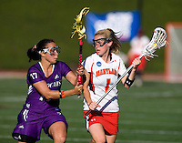 Sarah Mollison (1) of Maryland is defended by Amanda Macaluso (17) of Northwestern during the NCAA Championship held in Johnny Unitas Stadium at Towson University in Towson, MD.  Maryland defeated Northwestern, 13-11, to win the title.