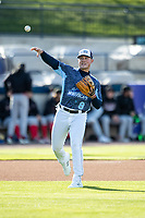 West Michigan Whitecaps third baseman Spencer Torkelson (8) makes a throw to first base against the Great Lakes Loons at LMCU Ballpark on May 11, 2021 in Comstock Park, Michigan. The Loons defeated the Whitecaps in their home opener 9-1. (Andrew Woolley/Four Seam Images)