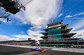 Scott Dixon, Chip Ganassi Racing Honda crosses the finish line under the checkered flag in third place