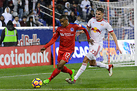 Harrison, NJ - Thursday March 01, 2018: Rony Martínez, Aaron Long. The New York Red Bulls defeated C.D. Olimpia 2-0 (3-1 on aggregate) during a 2018 CONCACAF Champions League Round of 16 match at Red Bull Arena.