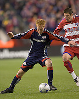 New England Revolution midfielder/defender Jeff Larentowicz (13) shields ball from FC Dallas forward Kenny Cooper (33). The New England Revolution defeated FC Dallas, 2-1, at Gillette Stadium on April 4, 2009. Photo by Andrew Katsampes /isiphotos.com