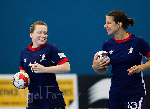 06 APR 2012 - LONDON, GBR - Heidi Møller Jensen (left) and Yvonne Leuthold warm up before the start of a Great Britain team training session at the National Sports Centre in Crystal Palace, Great Britain  (PHOTO (C) 2012 NIGEL FARROW)