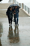 Venice Italy 2009. Tourists rain storm.