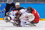 Sochi, RUSSIA - Mar 13 2014 - Tyler McGregor gets tied up with two USA players as Canada takes on USA in Sledge Hockey Semi-Final at the 2014 Paralympic Winter Games in Sochi, Russia.  (Photo: Matthew Murnaghan/Canadian Paralympic Committee)