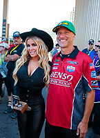 Jul 21, 2019; Morrison, CO, USA; NHRA pro stock motorcycle rider Matt Smith (right) poses for a photo with actress Carmen Electra prior to the Mile High Nationals at Bandimere Speedway. Mandatory Credit: Mark J. Rebilas-USA TODAY Sports