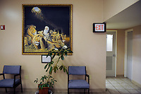 USA. Angola. 21st April 2008..Biblical paintings adorn the walls of the waiting room that joins onto the Death Chamber at Angola. The door on the right is the entrance to the Death Chamber..©Andrew Testa