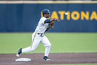 Michigan Wolverines second baseman Ako Thomas (4) turns a double play against the Maryland Terrapins on April 13, 2018 in a Big Ten NCAA baseball game at Ray Fisher Stadium in Ann Arbor, Michigan. Michigan defeated Maryland 10-4. (Andrew Woolley/Four Seam Images)