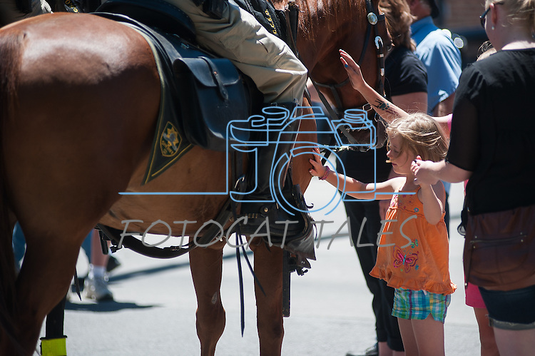 Brooke Smith, 7, pets a Carson City Sheriff's Officer's horse during Legends of the West in Carson City, Nev., on Saturday June 22, 2013.<br /> (Photo by Kevin Clifford/Nevada Photo Source)