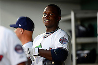 Fort Myers Miracle third baseman Miguel Sano #24 in the dugout after hitting a home run in the bottom of the first during a game against the Jupiter Hammerheads on April 9, 2013 at Hammond Stadium in Fort Myers, Florida.  Fort Myers defeated Jupiter 1-0.  (Mike Janes/Four Seam Images)