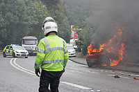 Pictured: A red Renault car is engulfed in flames. Wednesday 08 August 2018<br /> Re: Fire fighters had to attend the scene of a red Renault car which caught fire on the A467 near Crumlin, Wales, UK.