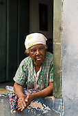 Lencois, Bahia State, Brazil. Elderly woman inhabitant leaning on her window sill.