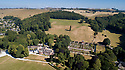 """19/06/18<br /> <br /> ***With video  https://www.youtube.com/watch?v=dRLkN49V02k  ***<br /> <br /> GV from drone showing parched 'One Tree Hill' in the background and Hopton Hall to left.<br /> <br /> It's not just a 'good year for the roses', it might be the best ever year for the roses.<br /> <br /> The colours from a rose garden in the Derbyshire Dales stand out like an oasis surrounded by parched fields because, unbelievably, the roses need NO water to bloom.<br /> <br /> Julie Thomas (59) who owns Hopton Hall near Ashbourne said: """"The roses are the best they've ever been, they love the dry hot and sunny conditions - we don't even need to water them. <br /> <br /> """"Usually the rain would knock the petals off and we be busy dead-heading at this time of year but there's hardly anything to do at the moment. The blooms are in a kind of drought state - the flowers are staying for much longer than usual. And there are lots more flowers coming too.<br /> <br /> The classic walled english rose garden was planted with 2000 roses 12 years ago by estate manager, Spencer Tallis (51). He planted all the roses and plants in the garden in 2004 and has since made it his life's work tending them.<br /> <br /> """"I do have to water the box hedges a little but the roses are looking after themselves. Normally at this time of year we'd all be busy dead-heading but there's hardly anything to do at the moment""""<br /> <br /> Julie and her family bought the property eight years ago and have continued to plant and care for the rose garden and now open the garden for visitors.<br /> <br /> All Rights Reserved: F Stop Press Ltd. +44(0)1335 344240 www.fstoppress.com www.rkpphotography.co.uk"""