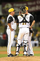 Jacksonville Suns pitching coach John Duffy (13) talks with pitcher Justin Nicolino (22) and catcher J.T. Realmuto (11) during game three of the Southern League Championship Series against the Chattanooga Lookouts on September 12, 2014 at Bragan Field in Jacksonville, Florida.  Jacksonville defeated Chattanooga 6-1 to sweep three games to none.  (Mike Janes/Four Seam Images)