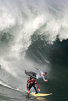 Ryan Steelbach (red) and Ross Clarke-Jones(wht) drop in together during the second heat of the 2008 Mavericks contest held at Pillar Point, Half Moon Bay, Calif., Saturday, January 12, 2008.