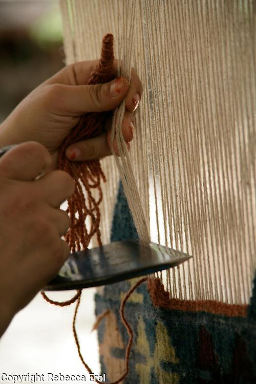 Weaving a woollen carpet, Cappadocia, Turkey