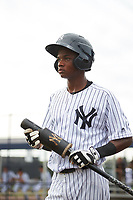 GCL Yankees East shortstop Jose Devers (5) on deck during the first game of a doubleheader against the GCL Yankees West on July 19, 2017 at the Yankees Minor League Complex in Tampa, Florida.  GCL Yankees West defeated the GCL Yankees East 11-2.  (Mike Janes/Four Seam Images)